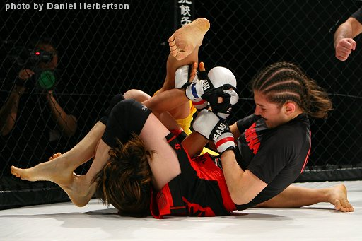 "Roxanne Modafferi defeated Chisa Yonezawa by unanimous decision, November 8th, 2008 in ""Valkyrie 01 Cage Force,"" Tokyo Japan.  She bumps her record up to 13 wins 4 losses."